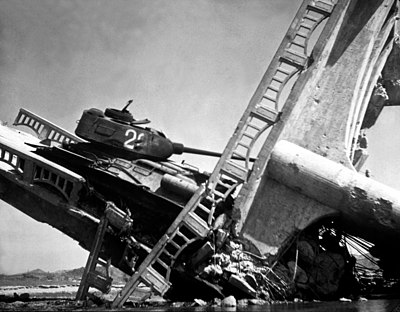 North Korean T-34-85 caught on a bridge south of Suwon by US attack aircraft in the Korean War Wrecked North Korean tank on bridge south of Suwon HD-SN-99-03158.JPEG