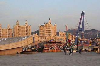 Xinghai Square amusement park with the Castle Hotel in the background Xinghai Square east.JPG
