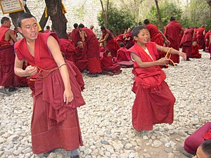 Buddhist monasticism - Young Buddhist monks in Tibet practising formal debating