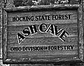 """HOCKING STATE FOREST"" ""ASH CAVE"" OHIO DIVISION OF FORESTRY"" sigbn detail, from- 1937 at Ash Cave (cropped).jpg"