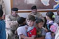 'Vanguard' Battalion soldiers help 9th Iraqi Army Division put smiles on childrens' faces at school supply drop DVIDS467707.jpg