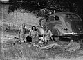 (Two men a woman and a dog picnic under a tree) (AM 77423-1).jpg