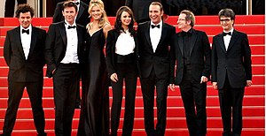 The Artist (film) - Some of the cast and crew at the 2011 Cannes Film Festival: (left to right), score composer Ludovic Bource, director Michel Hazanavicius, stars Missi Pyle, Bérénice Bejo, and Jean Dujardin, director of photography Guillaume Schiffman and producer Thomas Langmann.