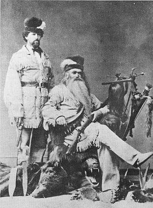 Seth Kinman - Seth (seated) with his son Carlin, displaying a few curiosities in 1876