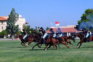 1st Cavalry Division (United States) - 1st Cavalry Division's Horse Cavalry Detachment charge during a ceremony at Fort Bliss, Texas, 2005.