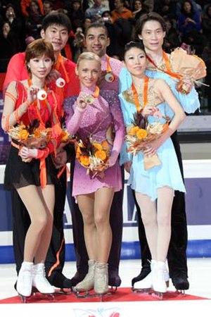 2007–08 Grand Prix of Figure Skating Final - The pairs' podium. From left: Zhang Dan / Zhang Hao (2nd), Aliona Savchenko / Robin Szolkowy (1st), Pang Qing / Tong Jian (3rd).