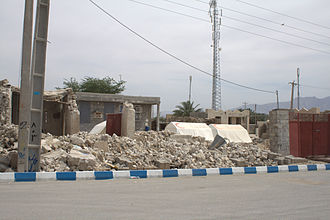 2013 Bushehr earthquake - Damage to houses caused by the earthquake, showing tents provided by the Red Crescent