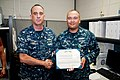 2014 - EM1 (SS) Kirby is awarded Navy and Marine Corps Achievement Medal by CDR Carius.jpg