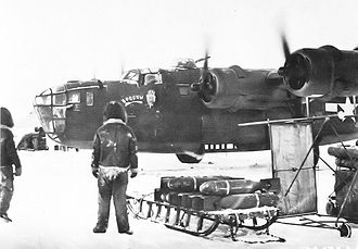 Amchitka Air Force Base - 21st Bomb Squadron B-24 Liberators at Amchitka.  Notice the sleds being used to transport bombs to the aircraft in the snow.