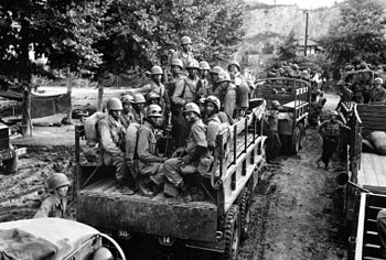 English: Men of the 24th Inf. Regt. move up to...