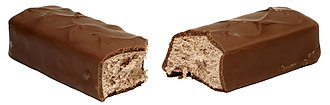 3 Musketeers (chocolate bar) - 3 Musketeers split in two, exposing the fluffy filling.