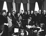 AR7813-B. President John F. Kennedy Signs Proclamation Declaring Sir Winston Churchill an Honorary Citizen of the United States.jpg