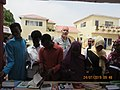 ASC Leiden - van de Bruinhorst Collection - Somaliland 2019 - 4706 - Young men and women in headscarfs at a book stall, with the photographer in their midst. Hargeysa 12th International Book Fair 20-25 July 2019.jpg