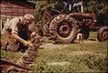 A 60-YEAR-OLD BACHELOR FARMER FROM BEANVILLE, NEAR RANDOLPH, VERMONT, ADJUSTS THE BLADES OF HIS MOWER BEFORE GOING... - NARA - 555528.tif