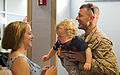 A U.S. Sailor, right, with Explosive Ordnance Disposal Group 2 is greeted by his family upon returning to Norfolk, Va., June 1, 2013, after a 12-month deployment to Afghanistan in support of Combined Joint Task 130601-N-AP176-102.jpg