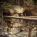 A bridge leading out of a tunnel in Taroko Gorge (12609604224).jpg