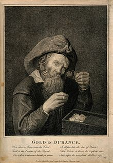 """""""Gold in Durance.""""A miser looks at his hoard of gold through his spectacles, with six lines of poetry by John Gay. (Source: Wikimedia)"""