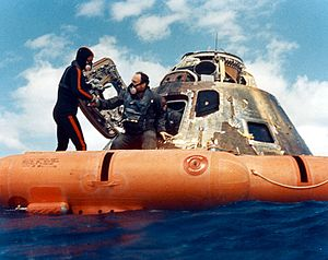 Edgar Mitchell - A US Navy diver helps Mitchell out of the space capsule, 1971