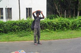 Abdullah Aarif taking photo on Wikipedia Photowalk at University of Chittagong (02).jpg