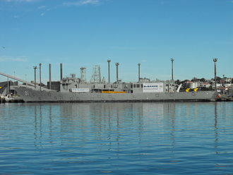 HMAS Adelaide (FFG 01) - Adelaide tied up at White Bay in April 2010. The vessel has been prepared for scuttling: weapons and systems have been removed, masts have been cut short, and diver access holes have been prepared.