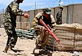 Afghan National Army trainee performs a combat training drill at Regional Military Training Center Gardez (3).jpg