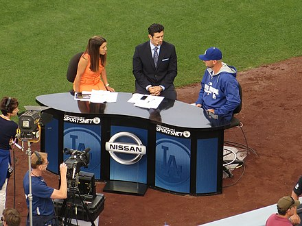 Garciaparra (center) with Alanna Rizzo (left) conducting a pregame interview at Dodger Stadium in 2014 Alanna Rizzo and Nomar Garciaparra, Dodger Pregame Broadcast, Dodger Stadium, Los Angeles, California (14516459724).jpg