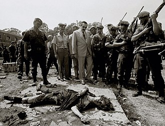1989 attack on La Tablada barracks - President Raúl Alfonsín (in pale suit) visits the site, where an MTP member lies after being killed by the Army