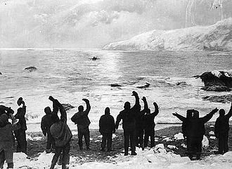 """All Safe, All Well"", allegedly depicting Shackleton's return to Elephant Island, August 1916. A photograph of the departure of the James Caird in April was doctored by photographer Frank Hurley to create this image. AllSafeAllWell.jpg"