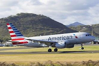 Hewanorra International Airport - American Airlines A319 taking off from Hewanorra International Airport