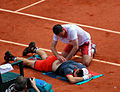Andy Murray receives medical treatment (1).jpg
