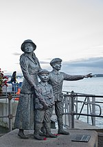Annie Moore Statue by by Jeanne Rynhart, Cobh.jpg