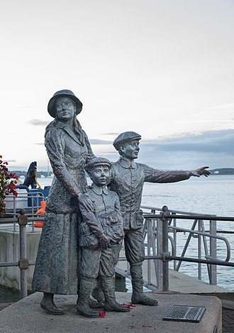 Cobh - Statue on the waterfront of Annie Moore and her brothers.  Annie Moore was the first person to be admitted to the United States of America through the new immigration centre at Ellis Island, New York on 1 January 1892.