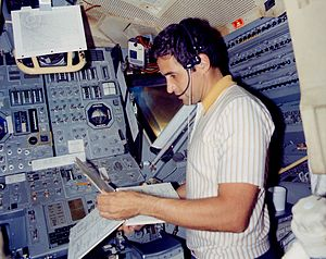Apollo 17 Jack Schmitt in the Lunar module simulator Ap17-KSC-72PC-539.jpg