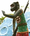 Armed monkey, Haw Par Villa (Tiger Balm Theme Park), Singapore (41378028).jpg