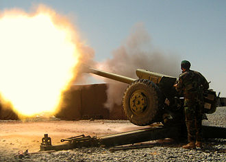 National Military Academy of Afghanistan - An artilleryman from the Afghan National Army's 205th Corps fires a round from a D-30 artillery piece during an indirect fire support mission, Sept. 9, 2007. For the past 10 months, U.S. embedded mentors have been helping train Afghans on Forward Operating Base Wolverine in Zabul province.