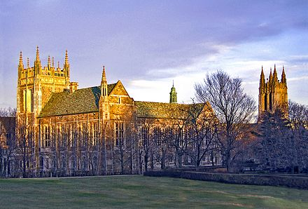 Boston College: the architecture style is Collegiate Gothic, a subgenre of Gothic Revival architecture, a 19th-century movement BCburnslawnsunset.jpg