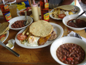 The bandeja paisa is the traditional dish of t...