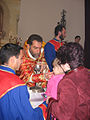 Bishop Sebouh Chouldjian giving communion to a child.jpg