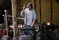 Blacksmith at the medieval reconstruction side Camous Galli.jpg