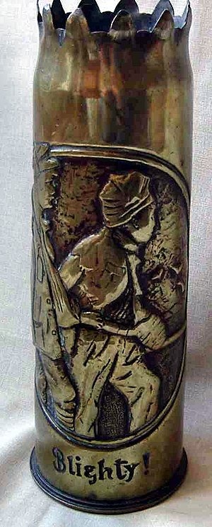 """Blighty - A World War I example of trench art: a shell case engraved with a picture of two wounded Tommies nearing the White Cliffs of Dover with the inscription """"Blighty!"""""""