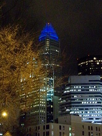 Bank of America Corporate Center - The Bank of America Corporate Center, with its crown lit in blue for a Carolina Panthers home night game.