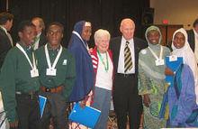 Nigerian exchange students meet Norman Borlaug (third from right) at the World Food seminar, 2003