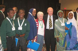 Norman Borlaug - Nigerian exchange students meet Norman Borlaug (third from right) at the World Food seminar, 2003.