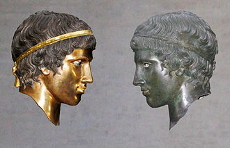 Gods in Color - Juxtaposition of the colored reconstruction and the weathered original of a bronze head in the Munich exhibition