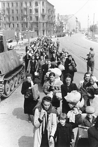 Wola massacre - A column of Polish women with children being led by German troops along Wolska Street in early August 1944
