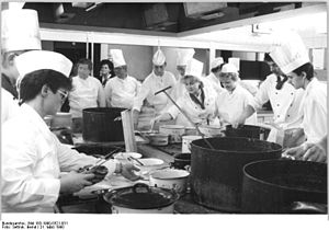 Cook (profession) - A group of professional and aspiring cooks in a hotel kitchen (1990)