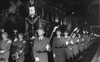 Großer Zapfenstreich - The band and torchbearers during a 1974 Großer Zapfenstreich to celebrate the 25th anniversary of the NVA.
