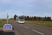 Bus na Comhairle Optare Solo YJ14BDY is seen in Sandwick in May 2020.jpg