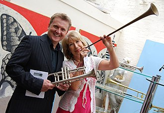 Aled Jones - Jones (left) pictured with Jennie Bond, during filming for Cash in the Attic in 2010