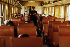 A conductor collects tickets aboard a Midwestern Turboliner in 1974.